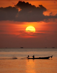 Squid fishing boat passing under the setting sun in Ko-Panang , Thailand. Image by photographer Dan Splaine.©2011 Daniel J. Splaine-TEST of TIME PHOTO